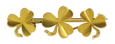 18ct gold bar brooch set with three clovers