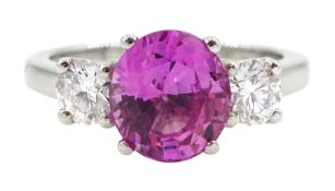 Platinum three stone oval pink sapphire and round brilliant cut diamond ring