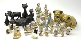 A collection of various ceramic figurines