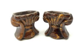 A pair of 19th century treacle glaze pottery sash window rests