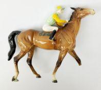 A Beswick jockey on horseback