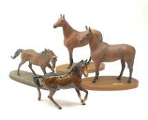 Four Royal Doulton horse figurines