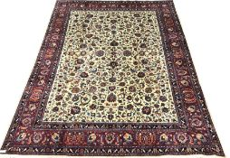 Kashan beige ground rug, trailing foliage field, red border with repeating pattern