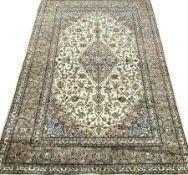 Keshan beige ground rug, central medallion, floral field repeating border