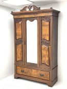 Late Victorian walnut wardrobe, scrolled pediment with central carving, enclosed by single bevelled