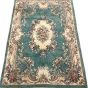 Chinese washed woollen turquoise ground rug, 277cm x 183cm