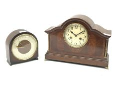 Early 20th century mahogany mantel clock, shaped moulded top over circular Arabic dial, the front in