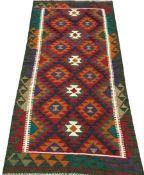 Maimana kilim red and green ground rug, repeating border