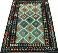 Choli Kilim blue ground rug, geometric patterned repeating border