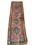 Turkish runner rug, red ground with quadruple pole medallion, three band border decorated with flowe