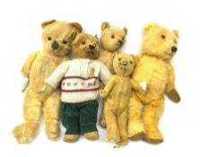 Five English teddy bears c1930s-50s including wood wool filled Chiltern with revolving head, glass e