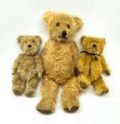 Three English teddy bears c1930s-50s comprising Chiltern wood wool filled Hug-Mee flat faced bear wi