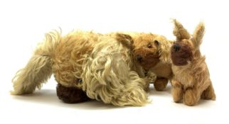 Farnell curly plush spaniel dog in a crouching position with glass eyes