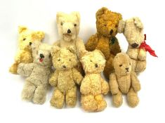 Eight 1950s European small teddy bears including a German one with open mouth