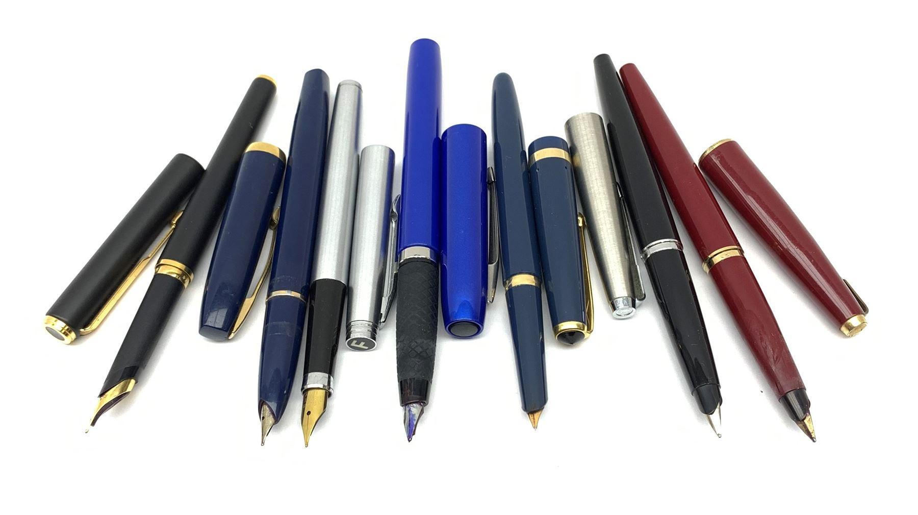 A group of fountain pens