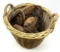 Herring net with six cork floats contained in a large two-handled wicker basket H45cm