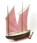 Mid-20th century pond yacht with red and black painted wooden hull