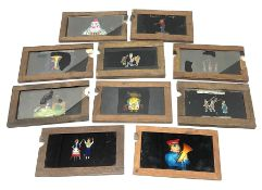 Ten 19th century wooden framed glass animated magic lantern 'slipping' slides of comical figures and