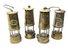 Four miner's lamps - two all brass by The Protector Lamp & Lighting Co. Ltd.H25cm; and two (one all