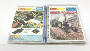 Modern loose leaf binder containing sixteen 1960s/1970s model railway catalogues including almost co