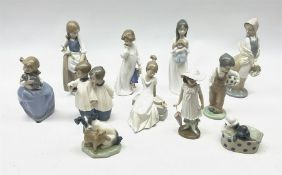 A group of assorted Nao figures