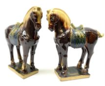 A pair of glazed pottery Tang style horses