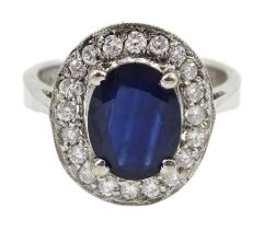 White gold oval sapphire and diamond cluster ring