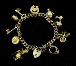 9ct gold curb chain bracelet with heart locket and ten 9ct gold charms including Donald Duck