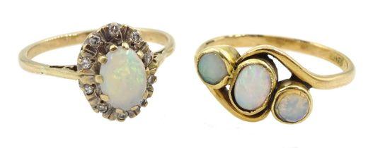 Gold three stone opal ring