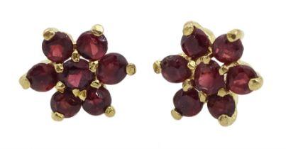 Pair of 9ct gold garnet flower stud earrings
