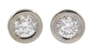 Pair of 18ct white and yellow gold round brilliant cut diamond stud earrings