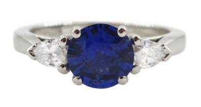Platinum round Ceylon sapphire and pear shaped diamond three stone ring
