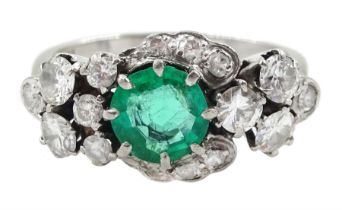 White gold round emerald and diamond cluster ring