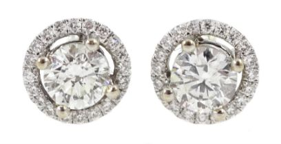 Pair of 18ct white gold round brilliant cut diamond halo stud earrings