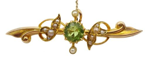 Edwardian gold peridot and split seed pearl bar brooch stamped 15ct