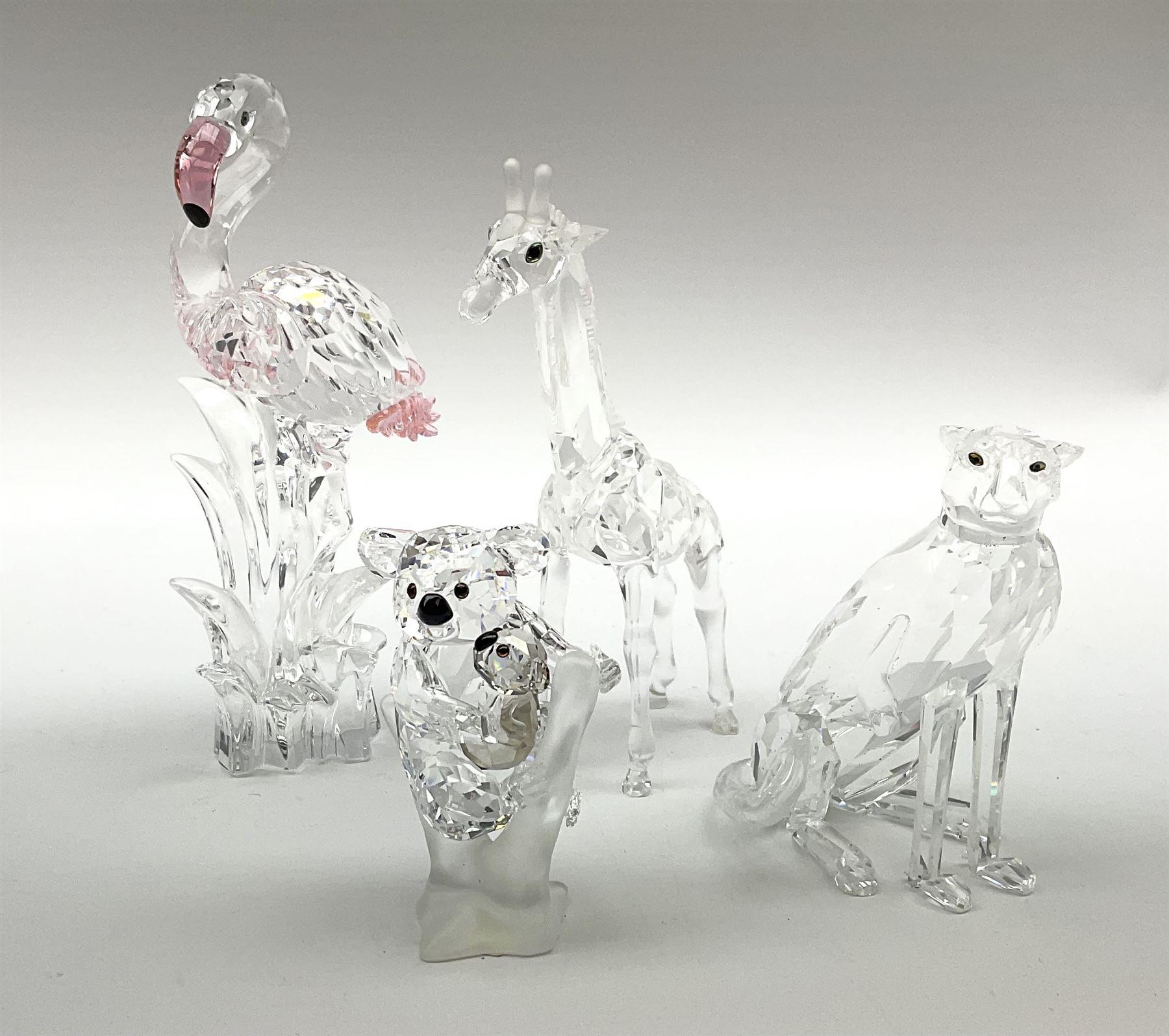 A group of four Swarovski Crystal figures