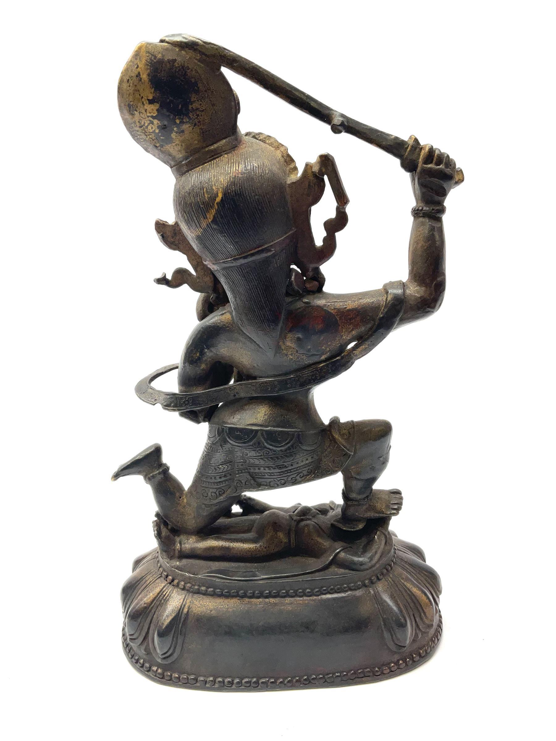 An eastern figure bronzed figure modelled as female deity kneeling upon figure - Image 2 of 2
