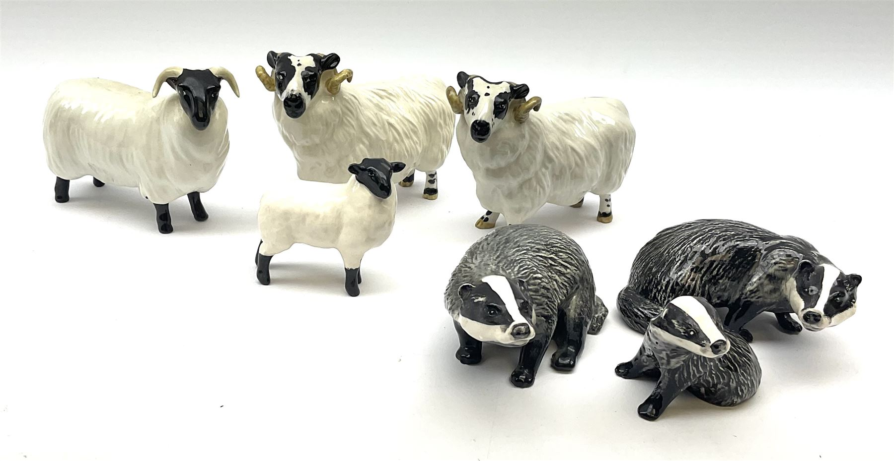 A Beswick Badger family comprising male