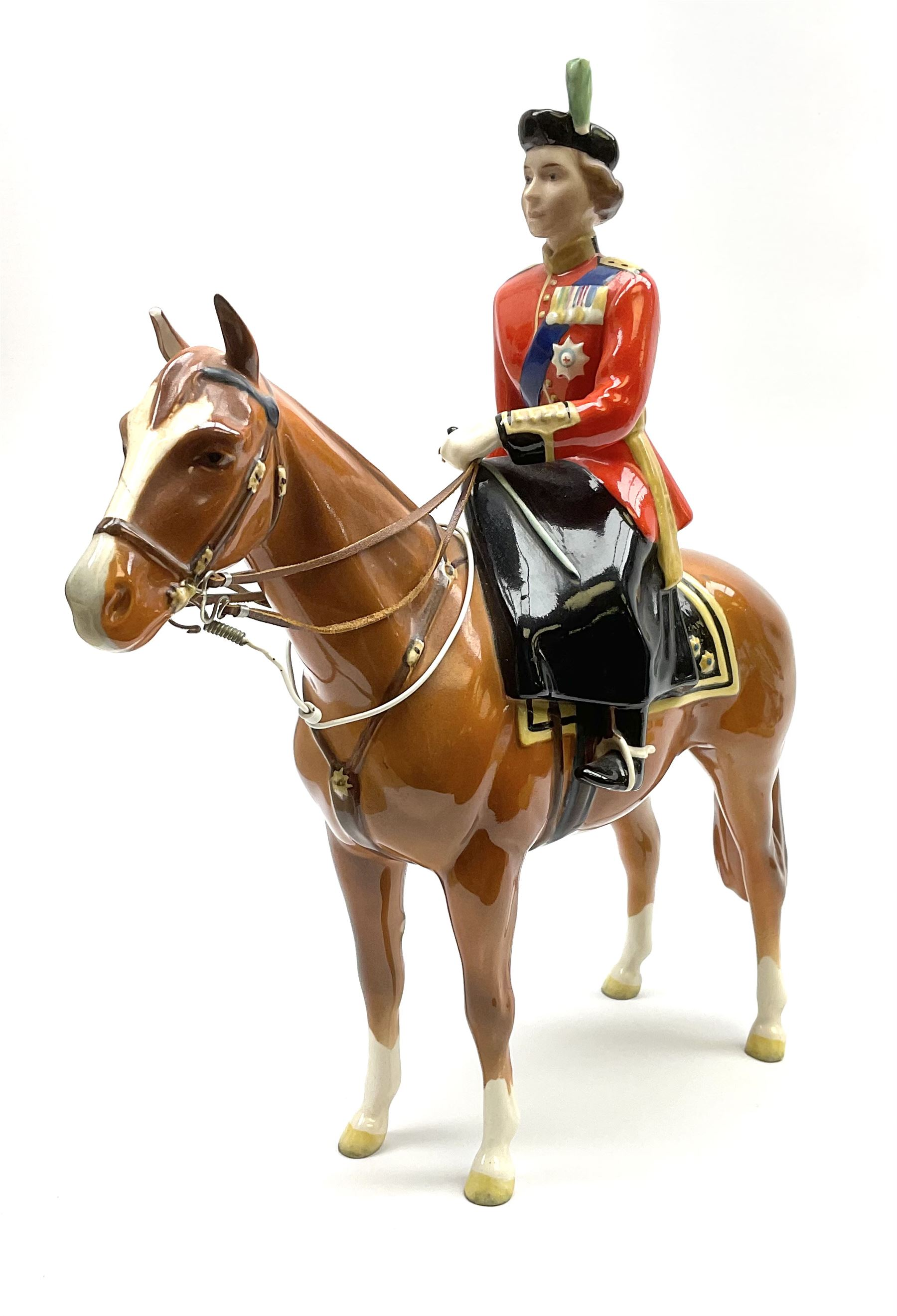 A Beswick model of HM Queen Elizabeth II mounted on Imperial Trooping the colour 1957