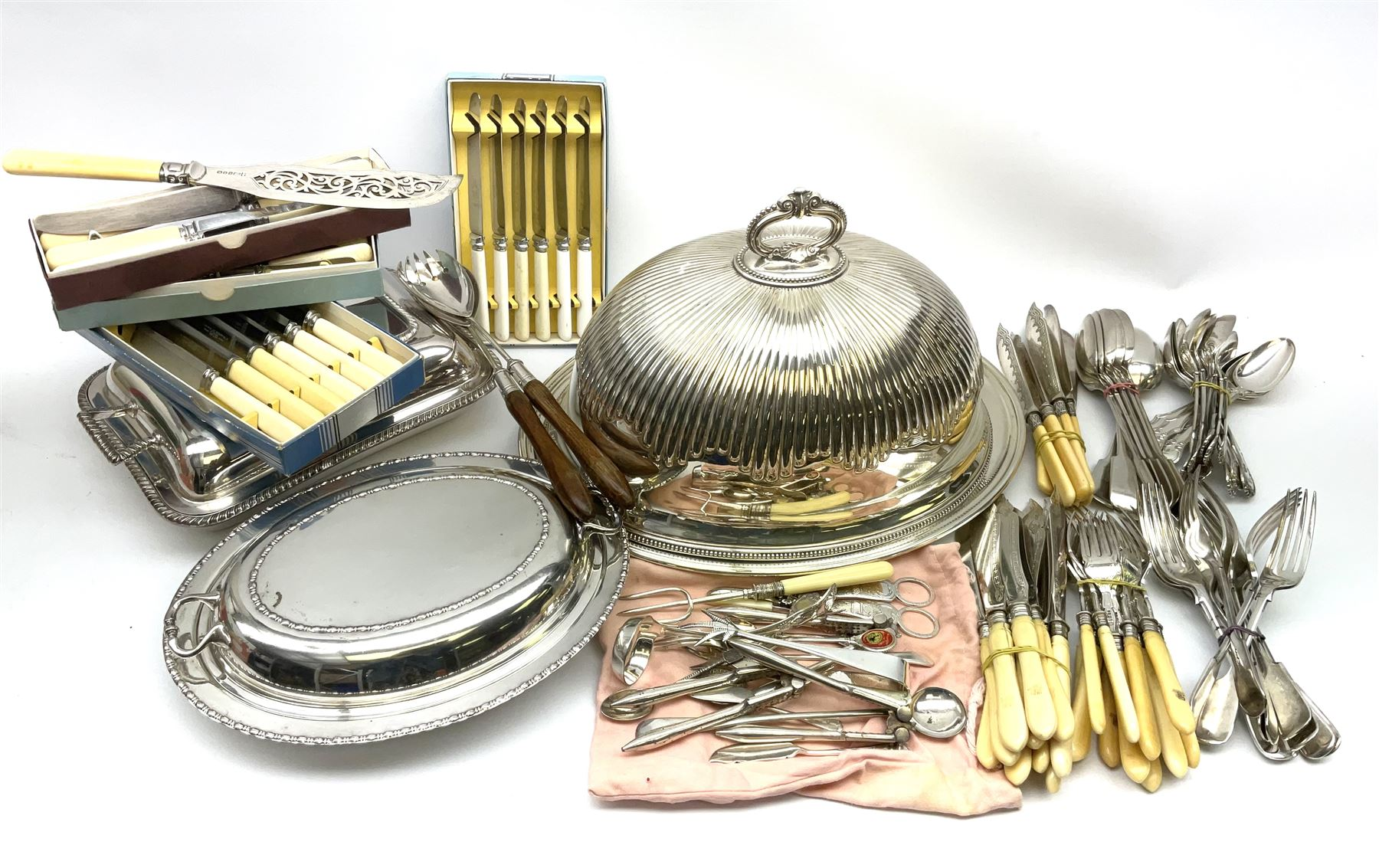A silver plated part fluted meat dome with beaded rim