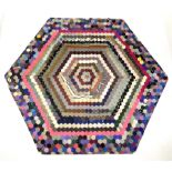 An early/mid 20th century hexagonal patchwork cover of hexagonal form