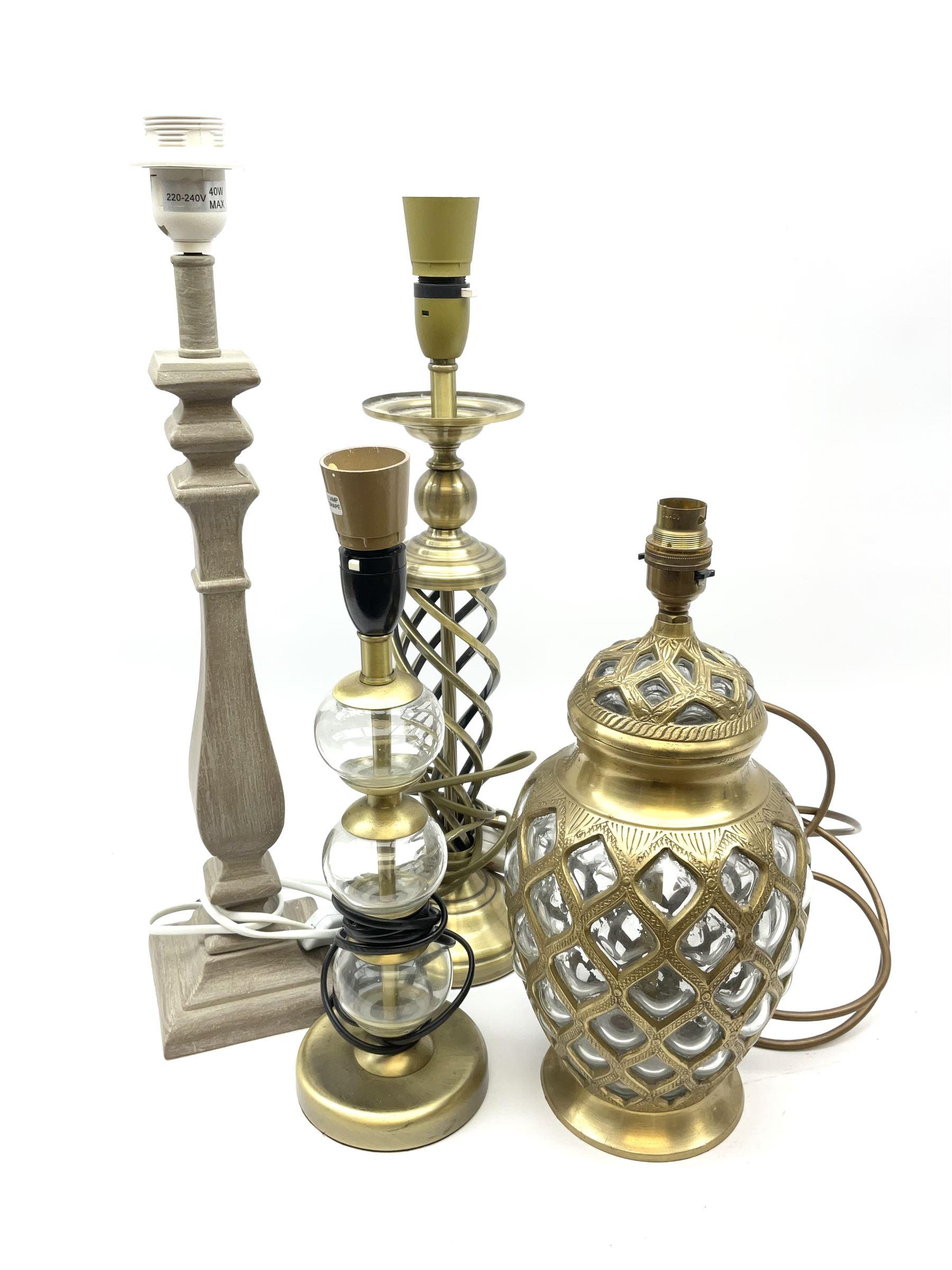 A glass and gilt metal overlaid table lamp