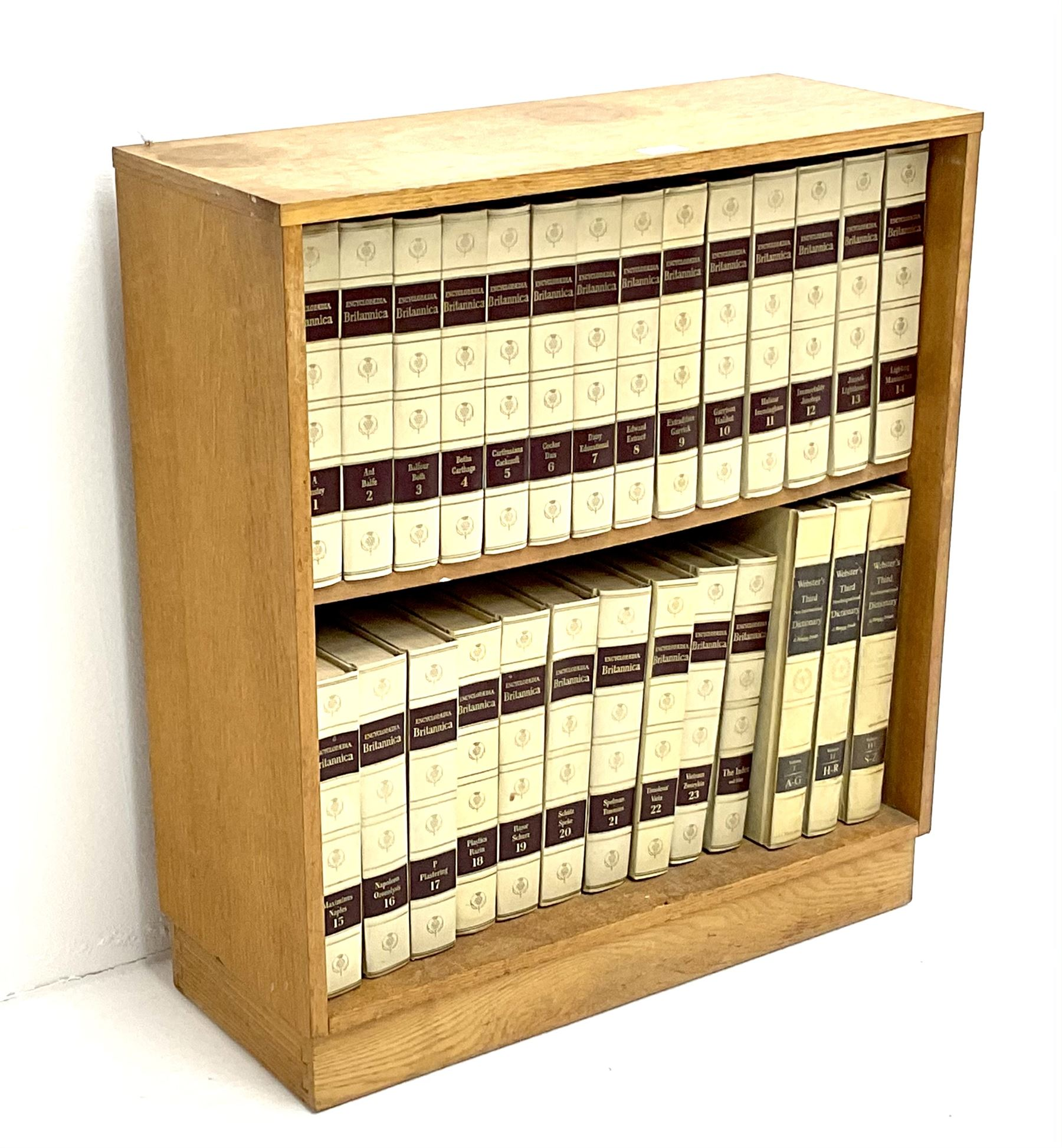Light oak bookcase with Encylopedia Britania