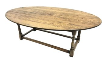 17th century style oval distressed light oak plank top dining table