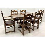 Mid to late century oak extending dining table four shaped supports on cup and cover column