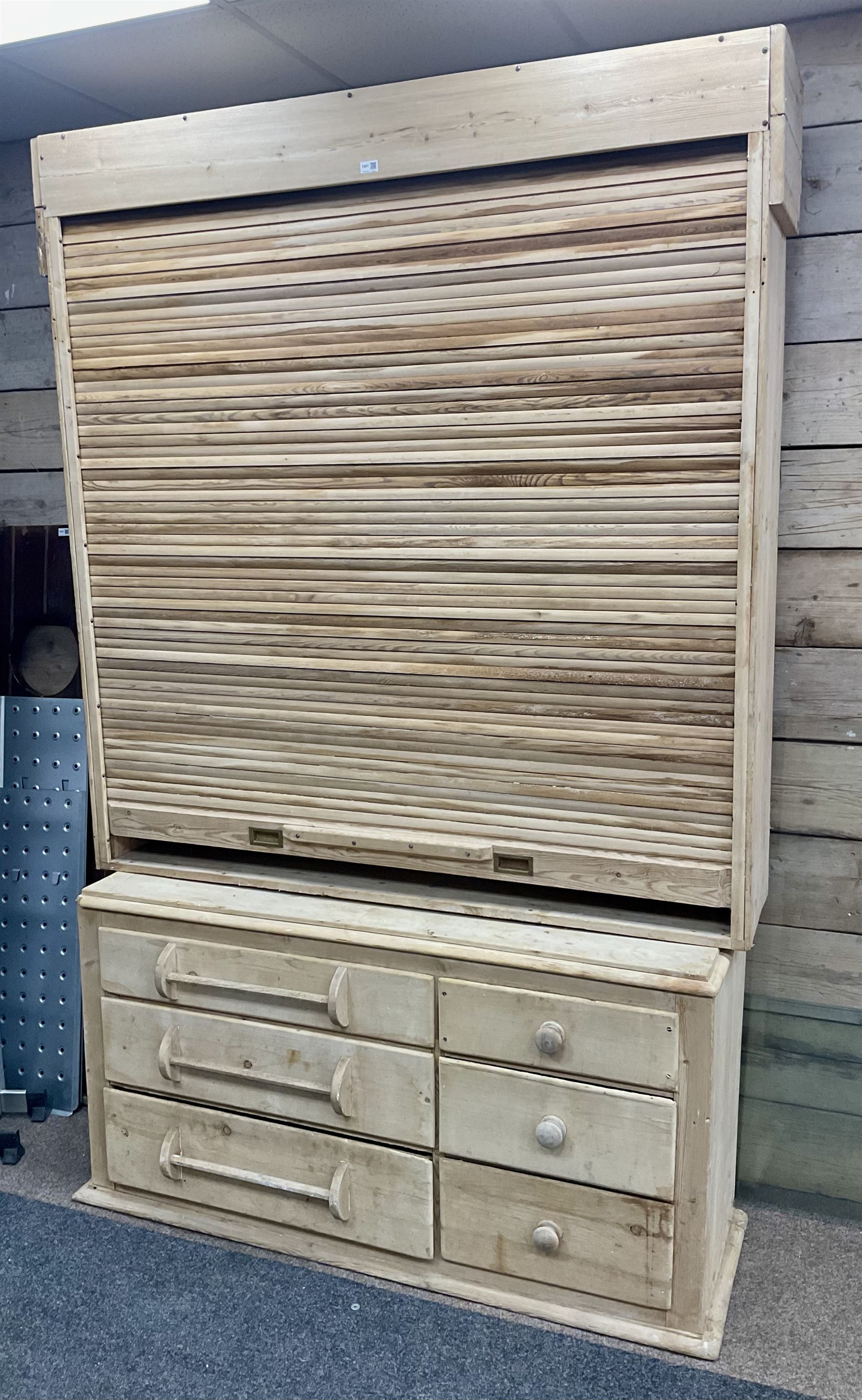 Large 19th century pine dresser with tambour roll top compartment enclosing four shelves above three