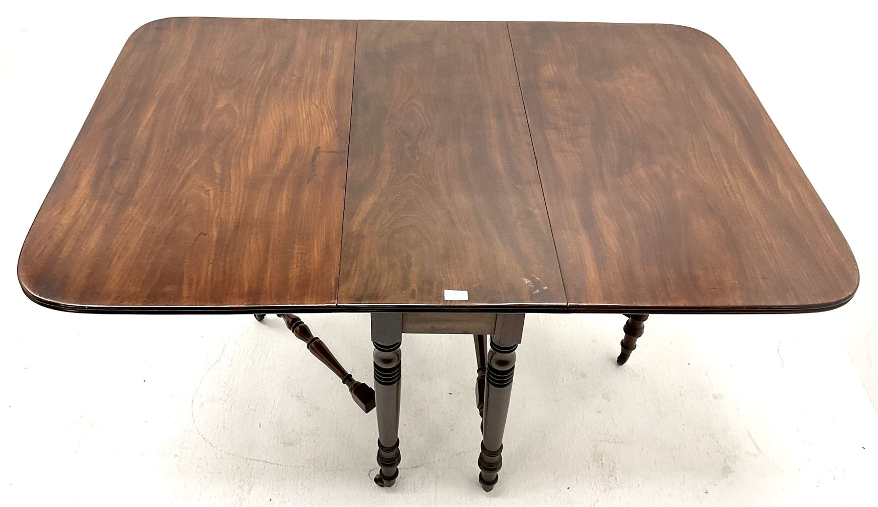19th century mahogany dropleaf table turned tapering supports joined by stretches - Image 3 of 3