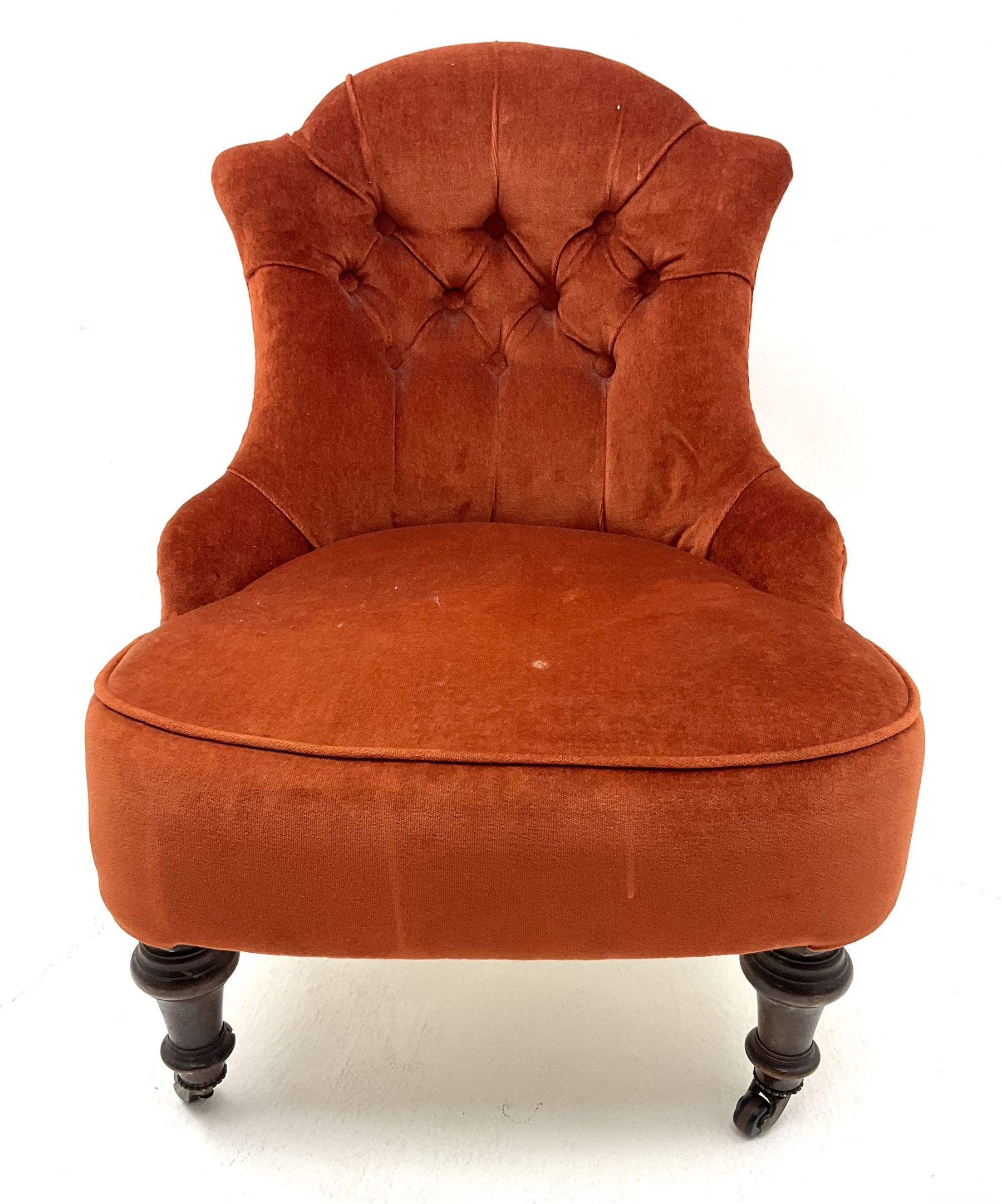 Victorian nursing chair upholstered in a buttoned terracotta fabric