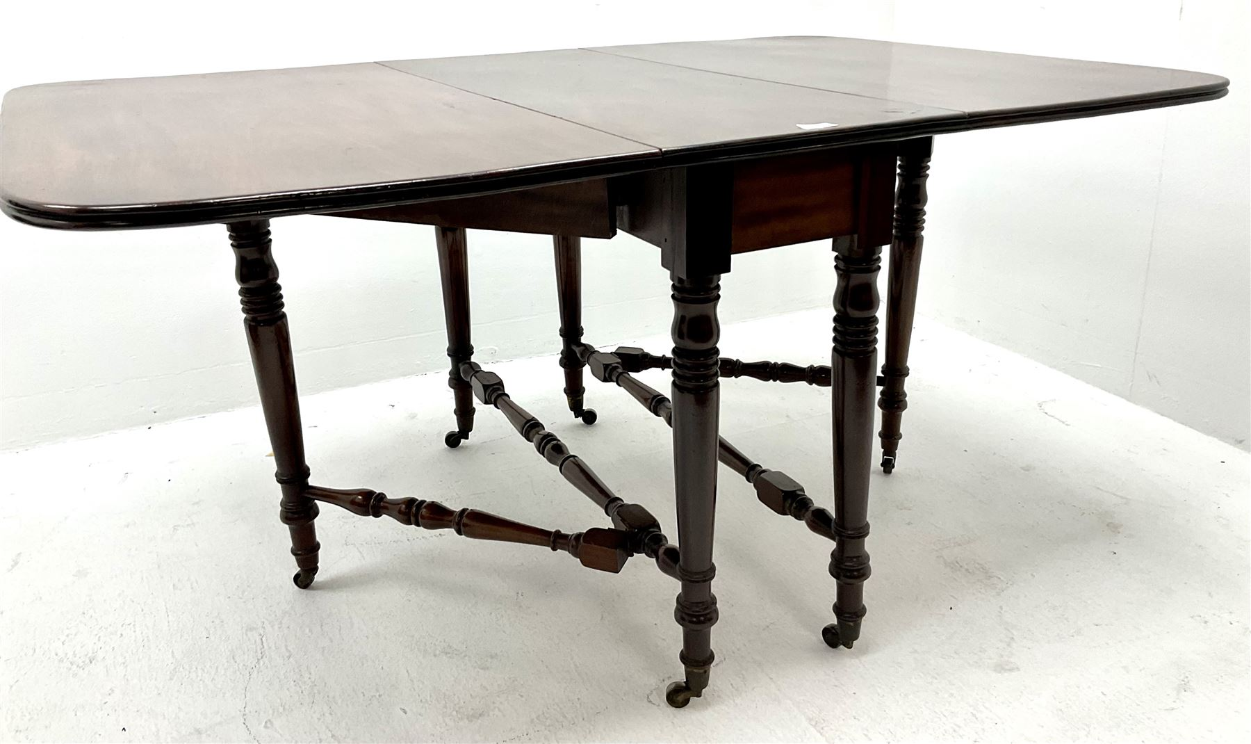 19th century mahogany dropleaf table turned tapering supports joined by stretches - Image 2 of 3