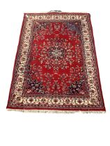 Persian style red ground rug